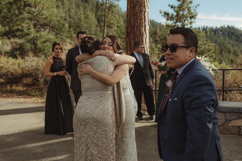 Logan Shoals elopement bride hugging her mom-in-law photo