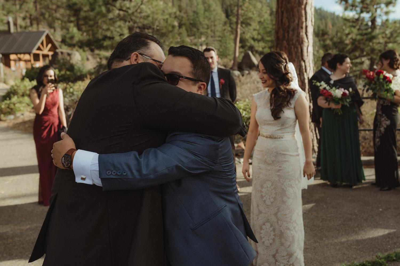 Logan Shoals elopement groom hugging his dad photo