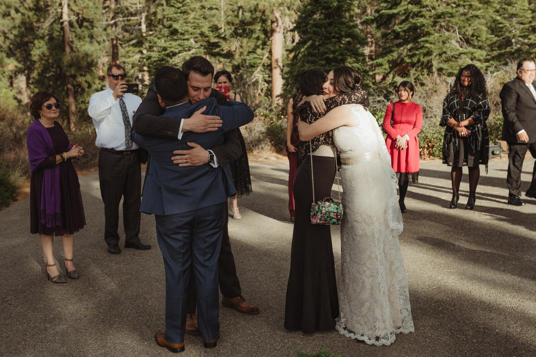 Logan Shoals elopement couple hugging their siblings photo