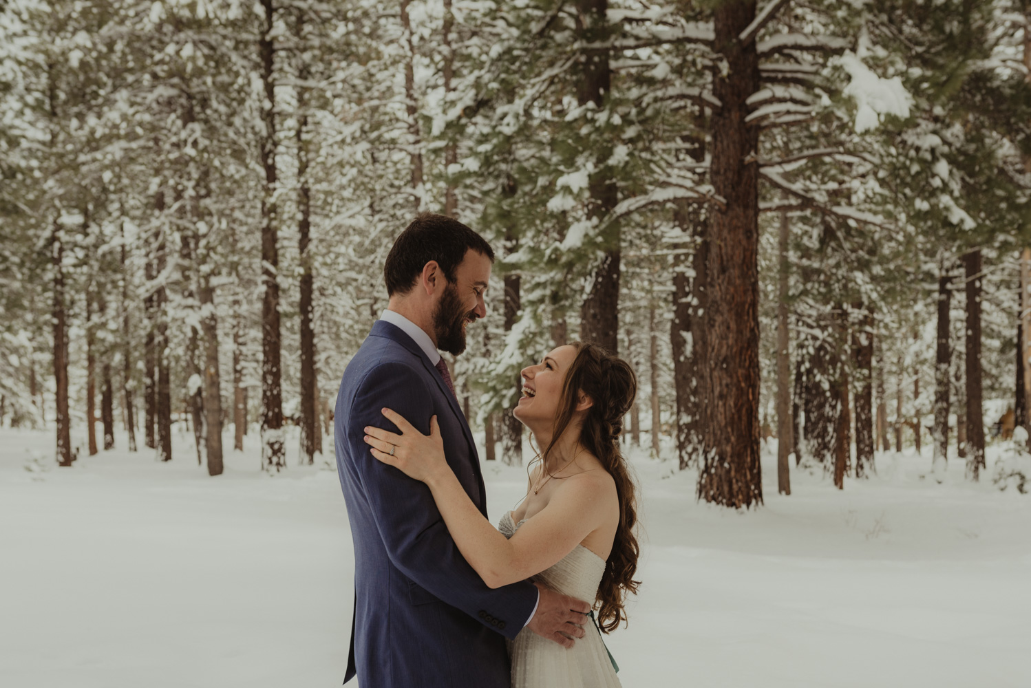 Lake Tahoe winter wedding couple laughing with each other photo