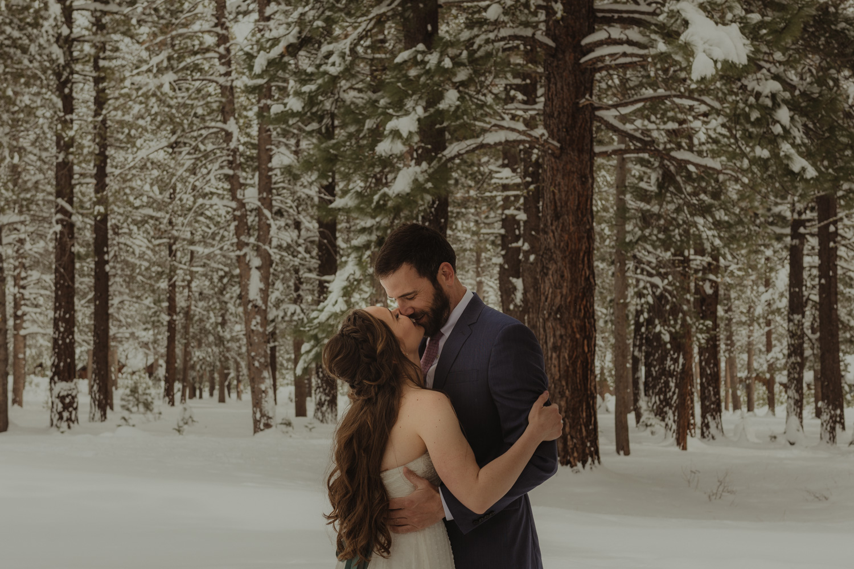 Lake Tahoe winter wedding couple kissing photo