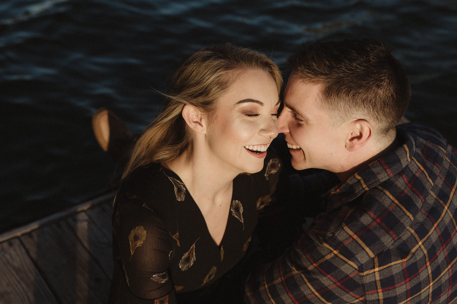 lake tahoe engagement photographer couple sitting on a dock in Truckee, CA photo