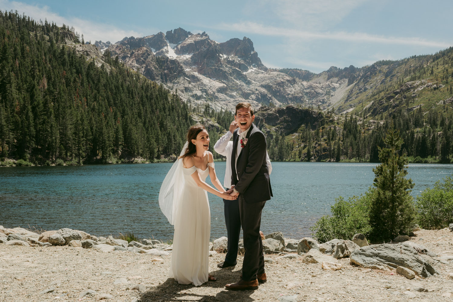 Elopement in the sierras photo, couple holding hands during the ceremony photo