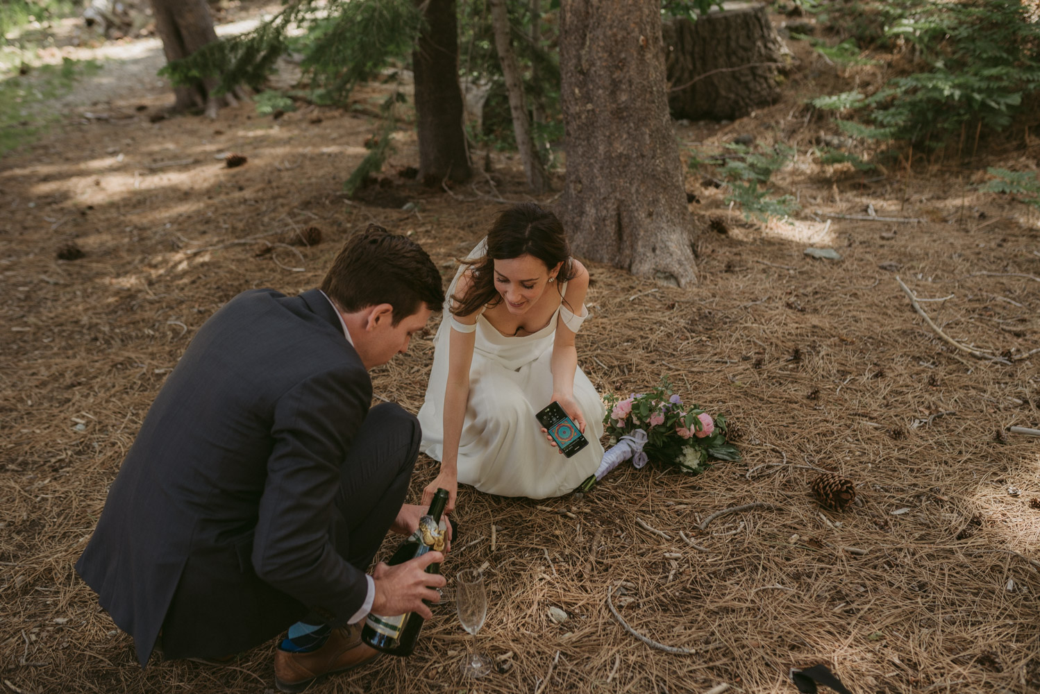 Sardine Lake Resort, Sierra Buttes elopement couple pouring champagne photo