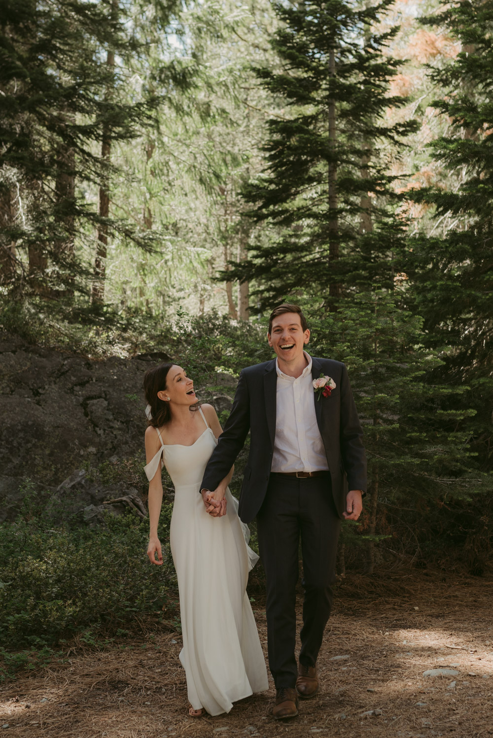 Lake Tahoe elopement photographer, couple laughing and holding hands photo