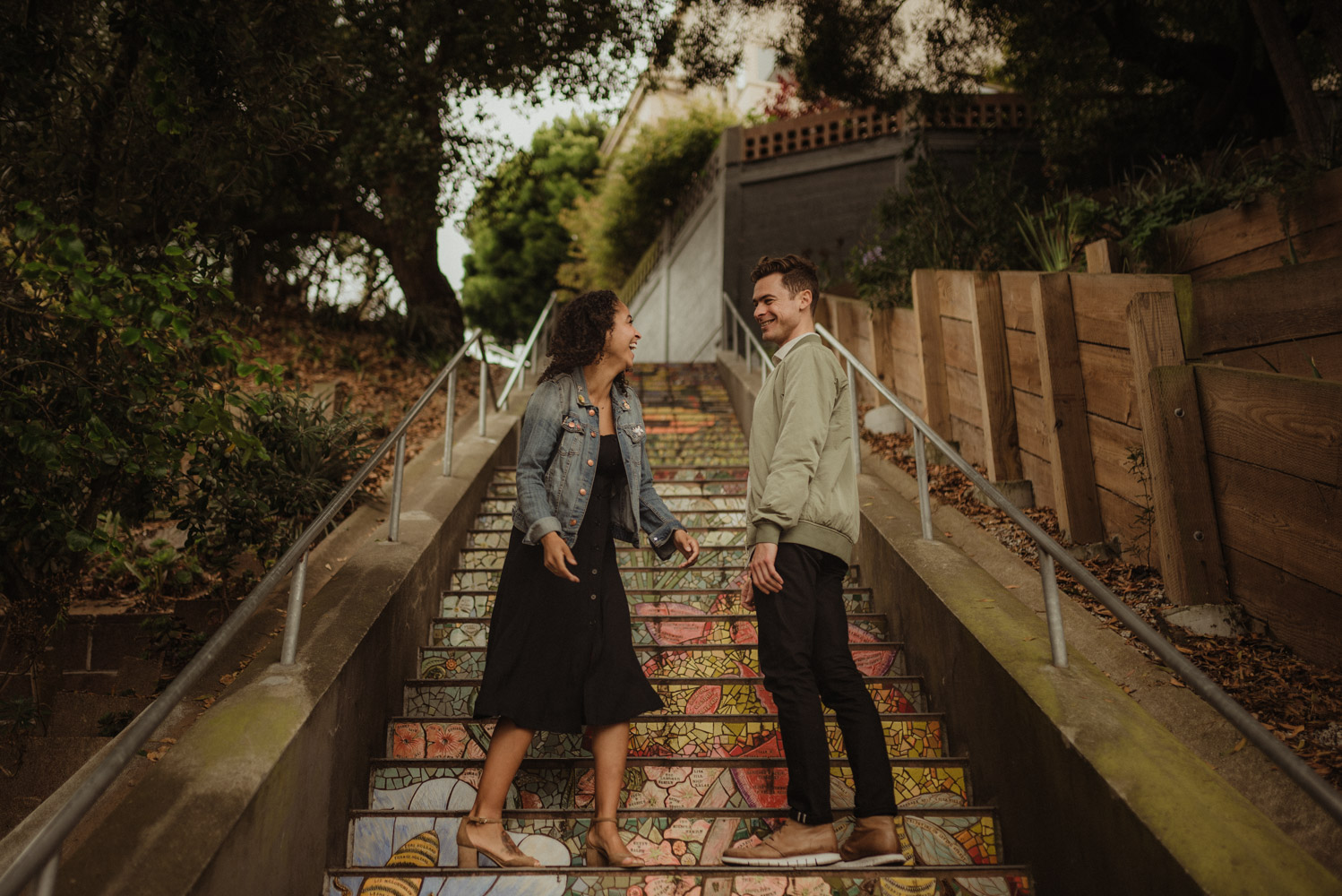 16th Avenue Tiled Steps in San Francisco engagement session, couple laughing photo