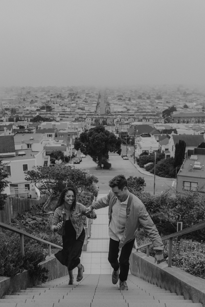 16th Avenue Tiled Steps engagement session, couple running up the tiles photo
