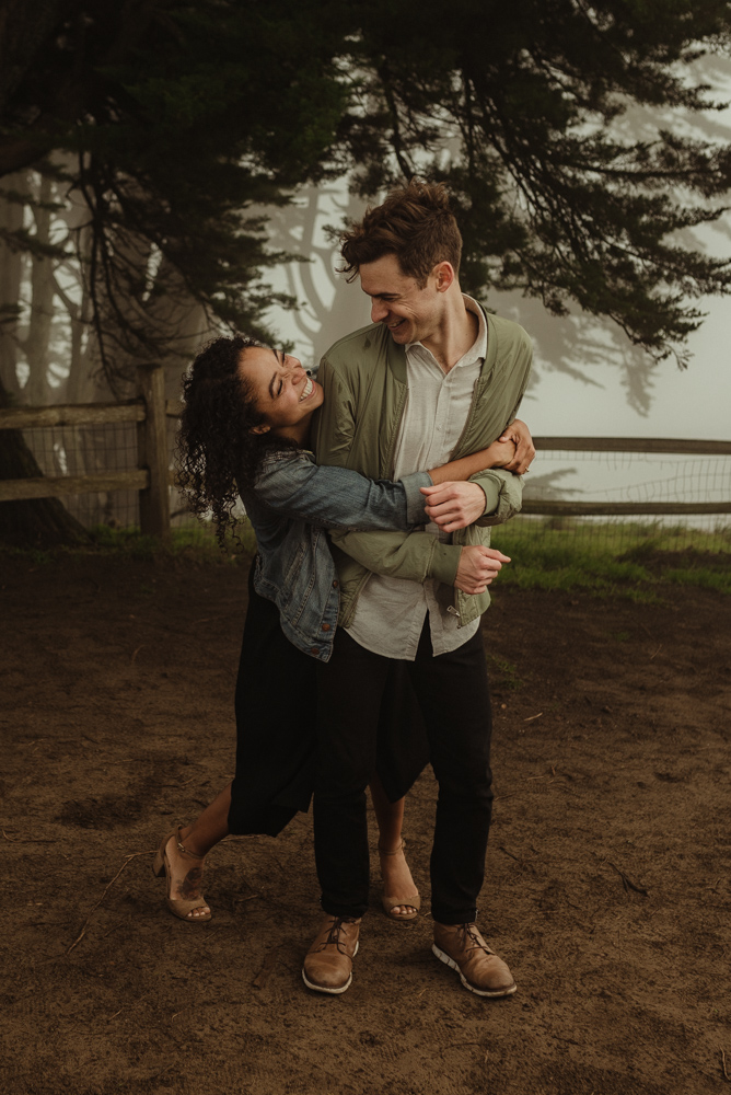 San Francisco foggy engagement session couple hugging photo