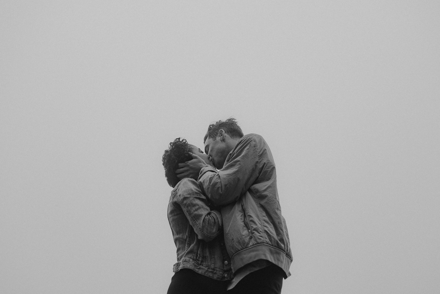 San Francisco foggy engagement session couple embracing each other photo