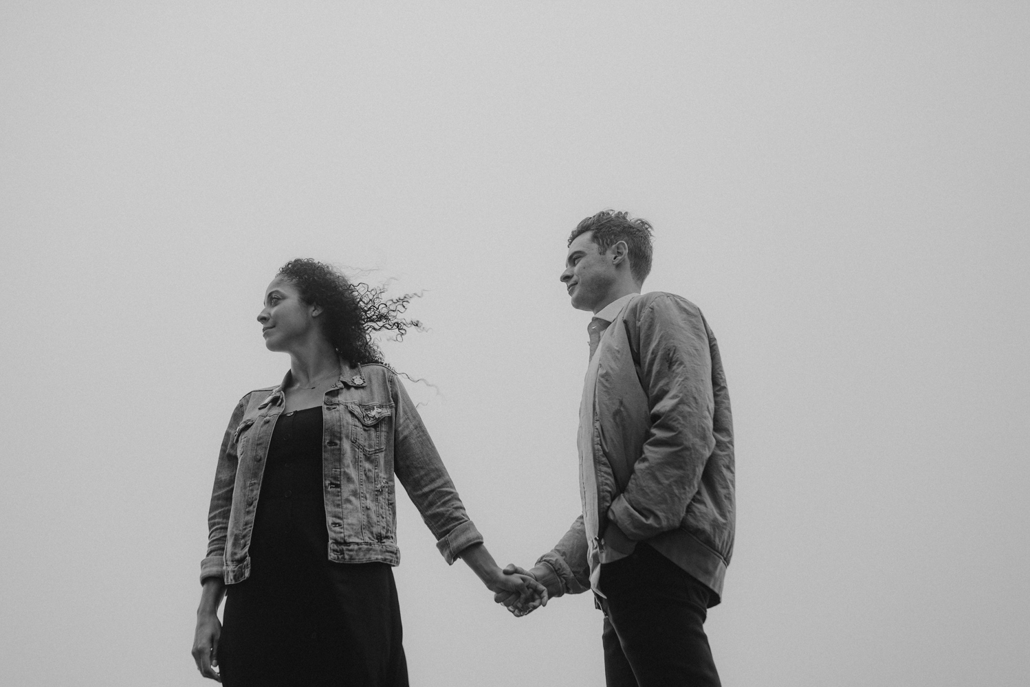 San Francisco foggy engagement session couple holding hands photo