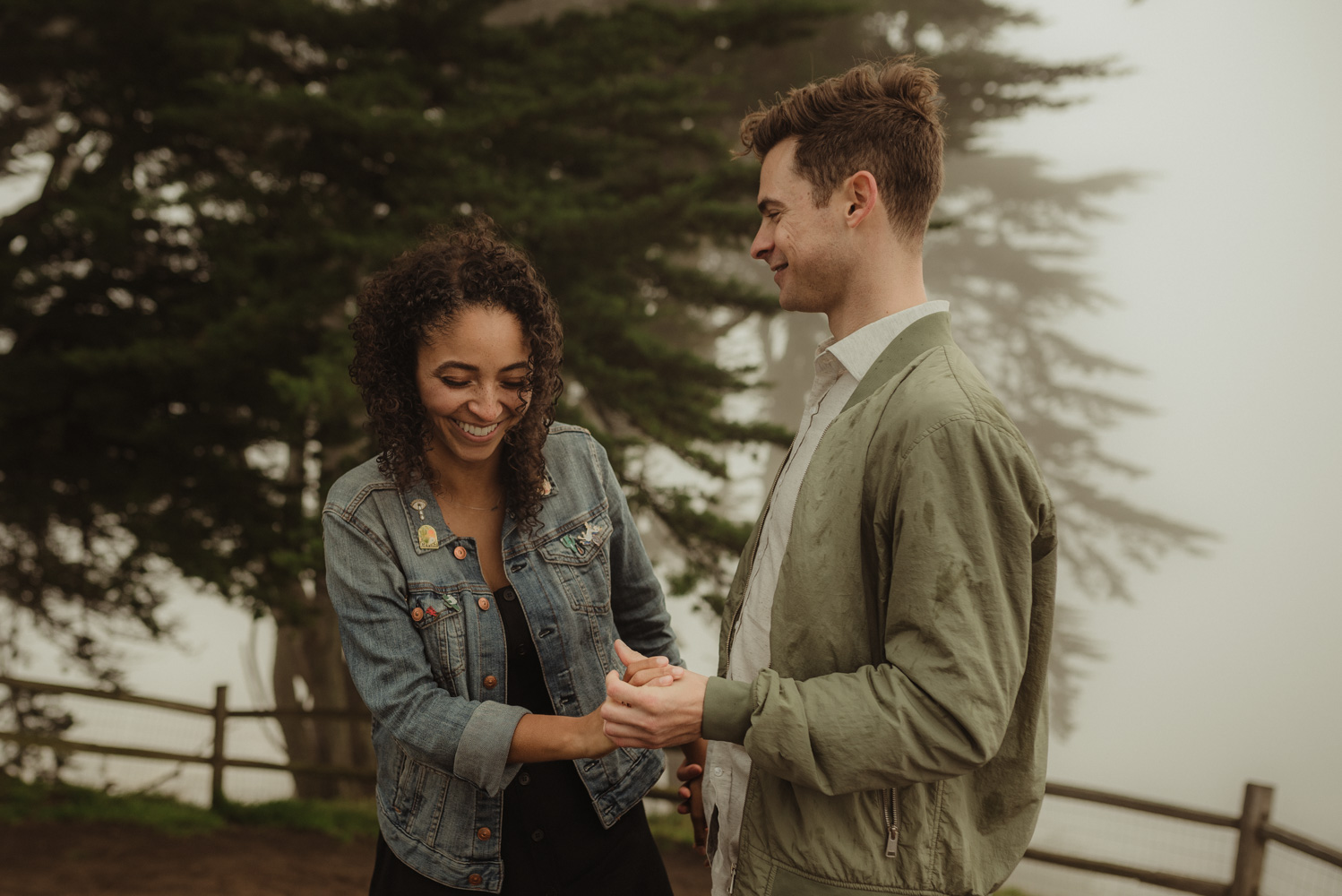 San Francisco foggy engagement session couple playing in the fog photo