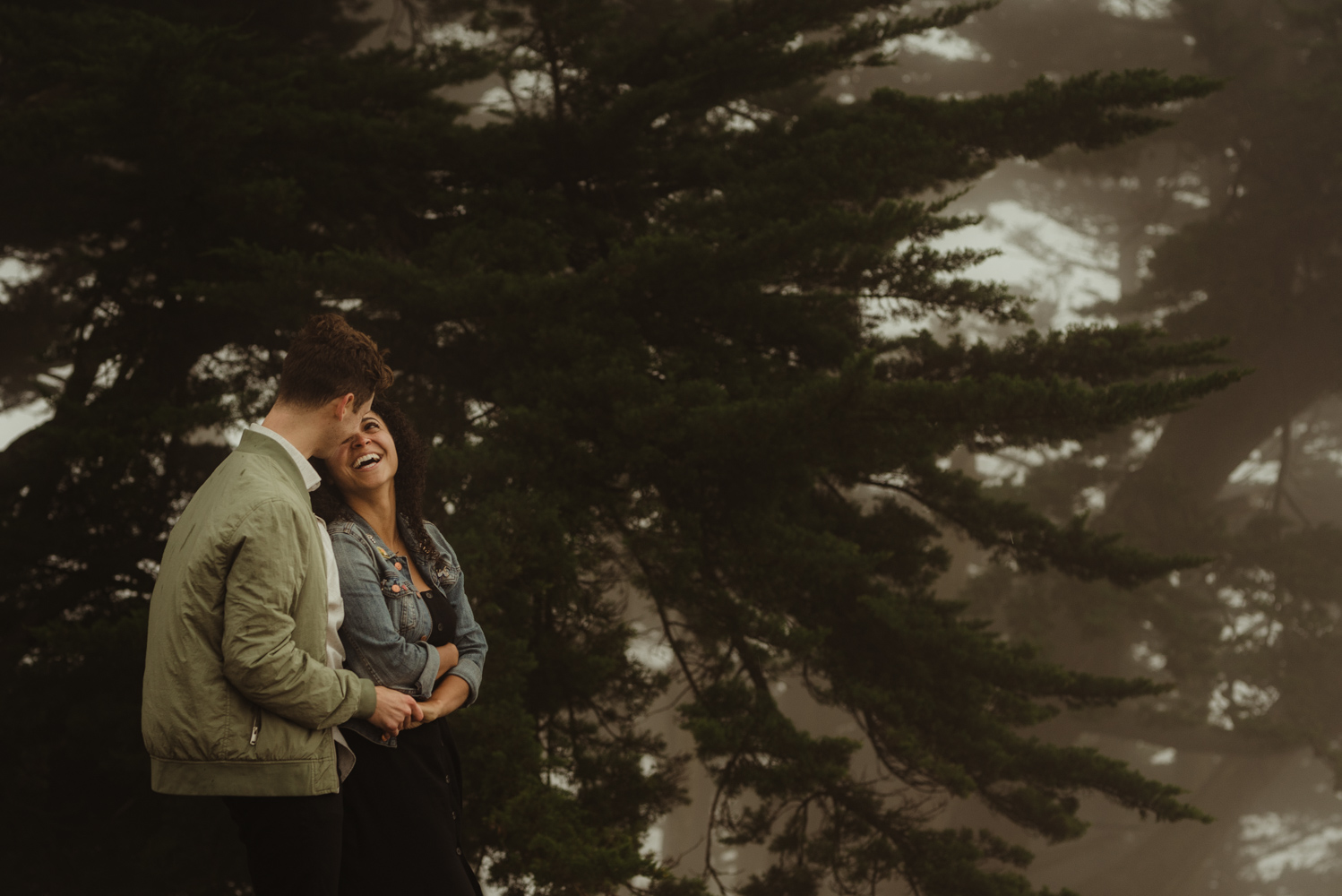 San Francisco foggy engagement session couple dancing in the fog photo