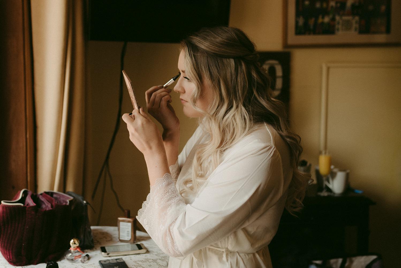 Twenty Mile House wedding bride getting her makeup done photo