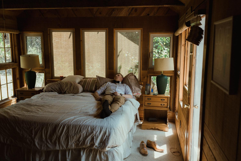 Twenty Mile House wedding groomsmen photo laying on the bed photo