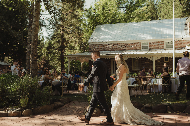 Twenty Mile House wedding couple walking in to their reception photo