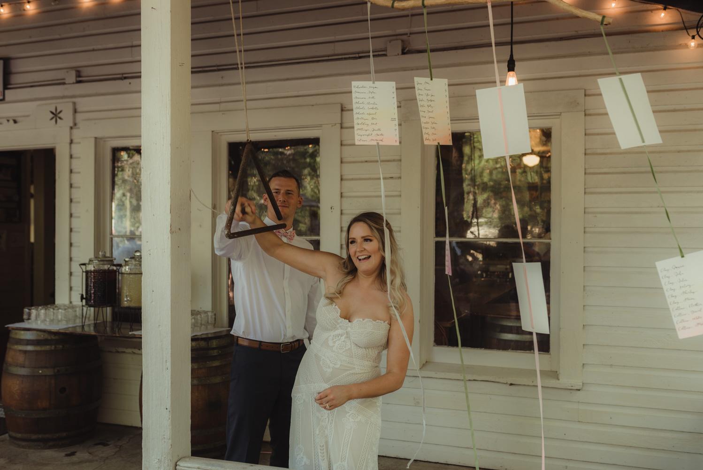 Twenty Mile House wedding couple ringing the bell photo