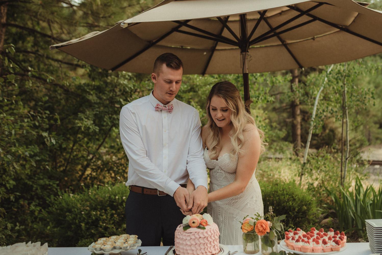 Twenty Mile House wedding couple cutting the cake photo