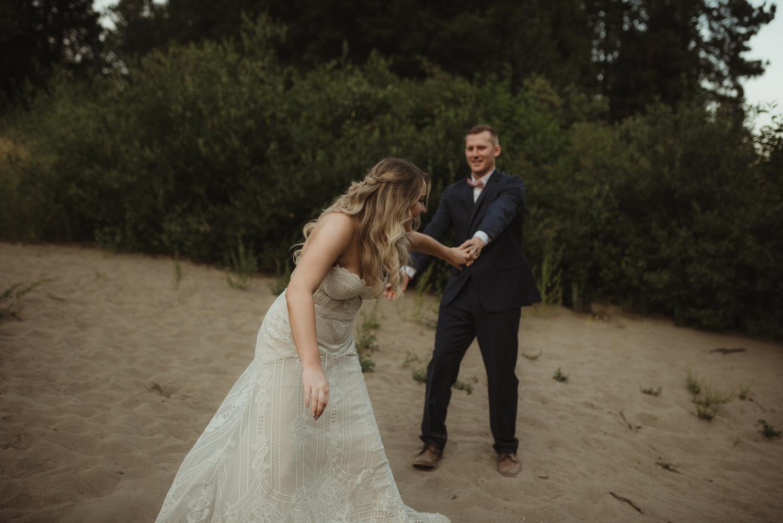 Twenty Mile House wedding couple holding hands photo