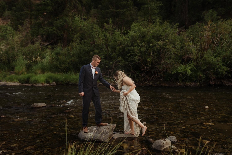 Twenty Mile House wedding couple walking on the river photo