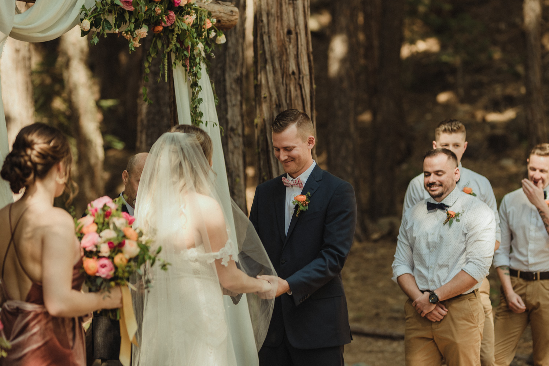 Twenty Mile House wedding groom smiling during the ceremony photo