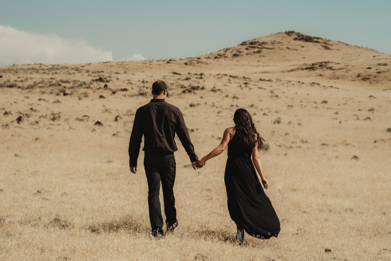 Nevada desert engament session inspiration couple walking on the fields photo