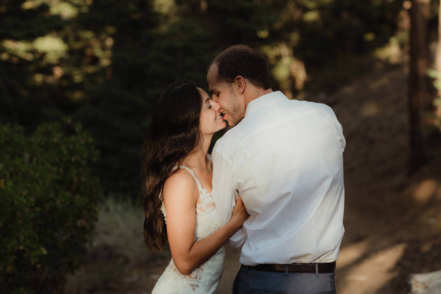 Lake Tahoe engagment session inspiration couple embracing each other in the forest photo