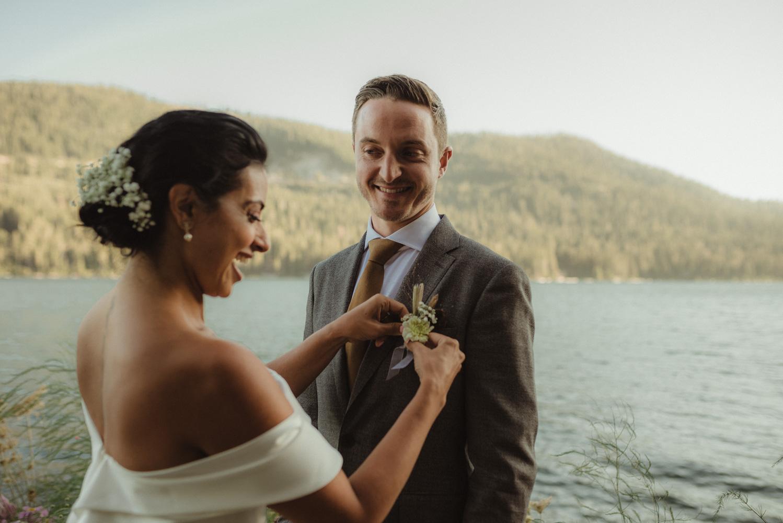 Lake Tahoe pop-up wedding/elopement bride putting on flowers photo