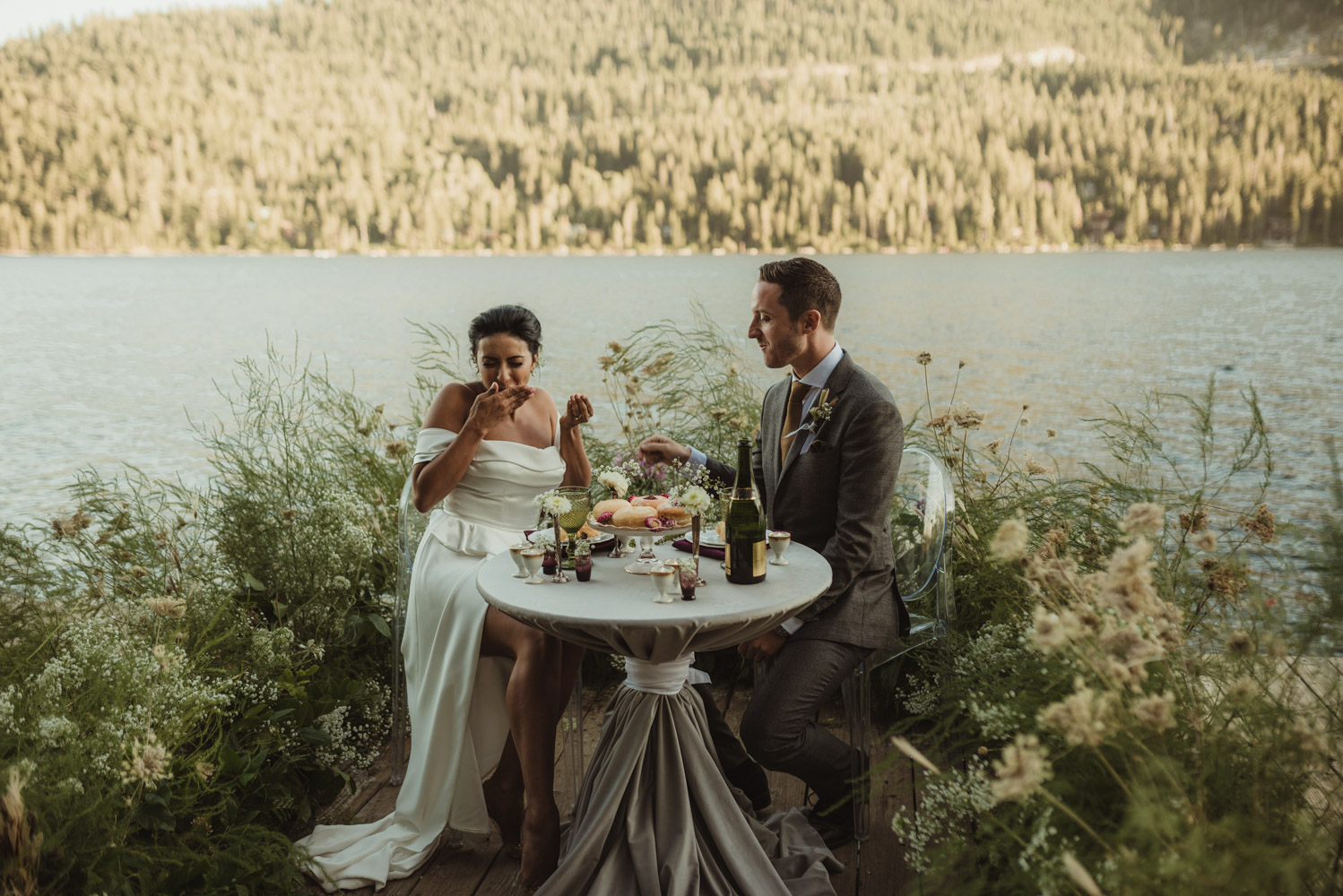 Lake Tahoe pop-up wedding/elopement couple feeding each other photo