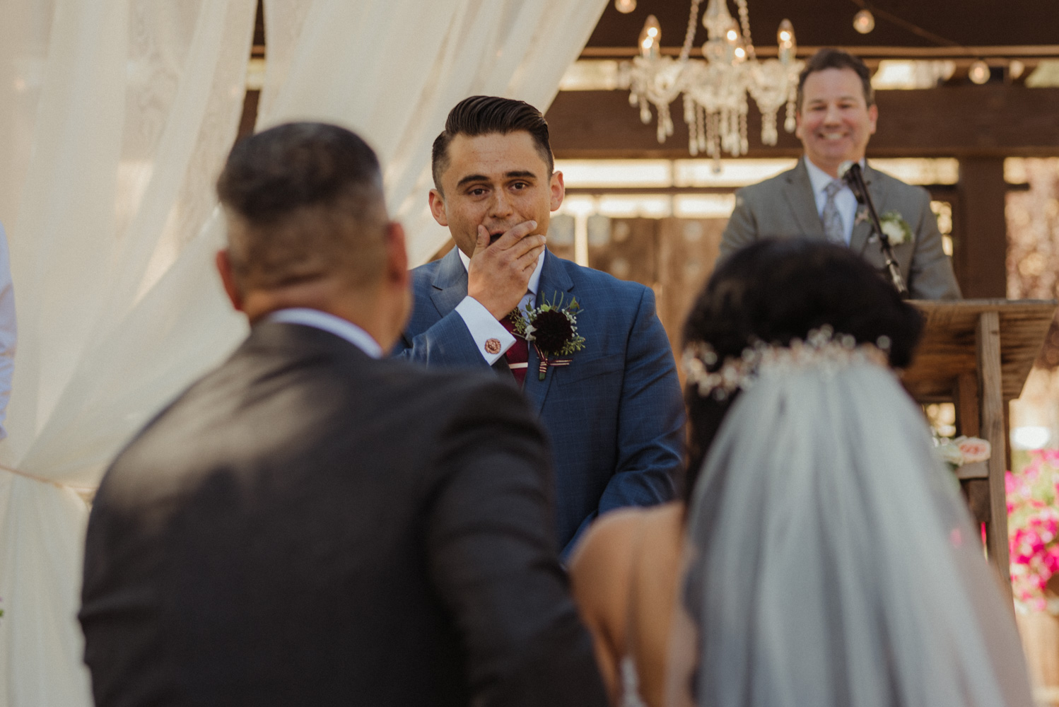 Ranch victoria vineyards wedding groom's reaction to his bride walking down the isle photo