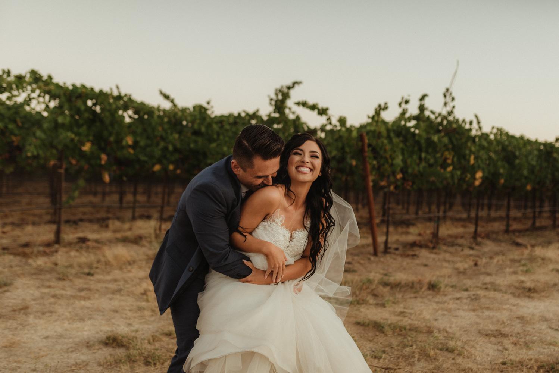 Ranch Victoria vineyard wedding couple hugging in the vineyard photo