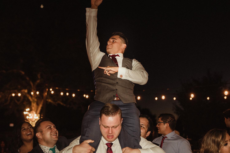 Ranch Victoria vineyard wedding groom getting picked up on the dance floor photo