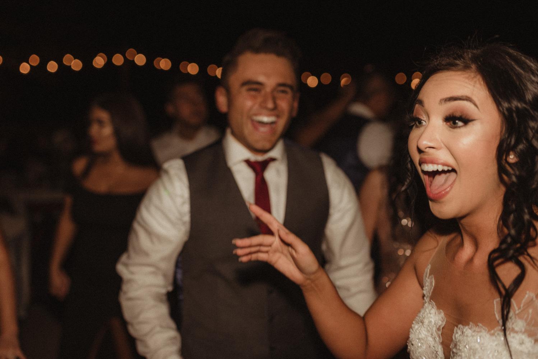 Ranch Victoria vineyard wedding groom smiling at his bride photo
