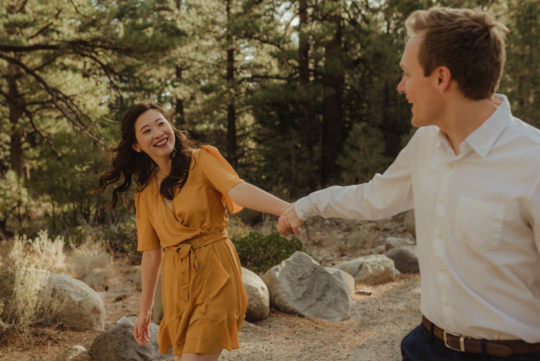 Galena Creek fall engagement session couple swinging around photo