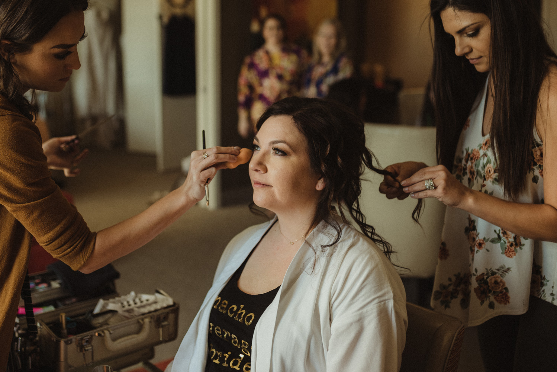 grand sierra wedding bride doing her makeup photo