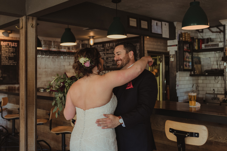 couple's wedding photos at a bar photo