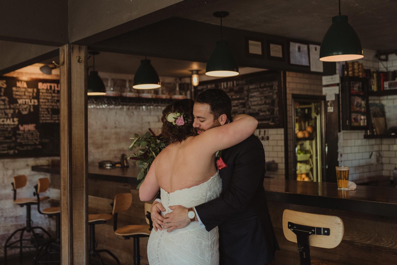 couple at a bar hugging photo