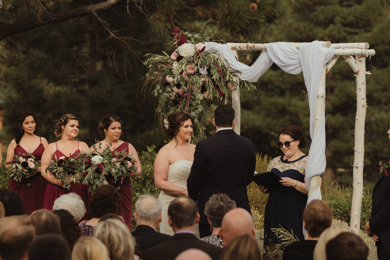 tannenbaum wedding venue bride smiling during the ceremony photo
