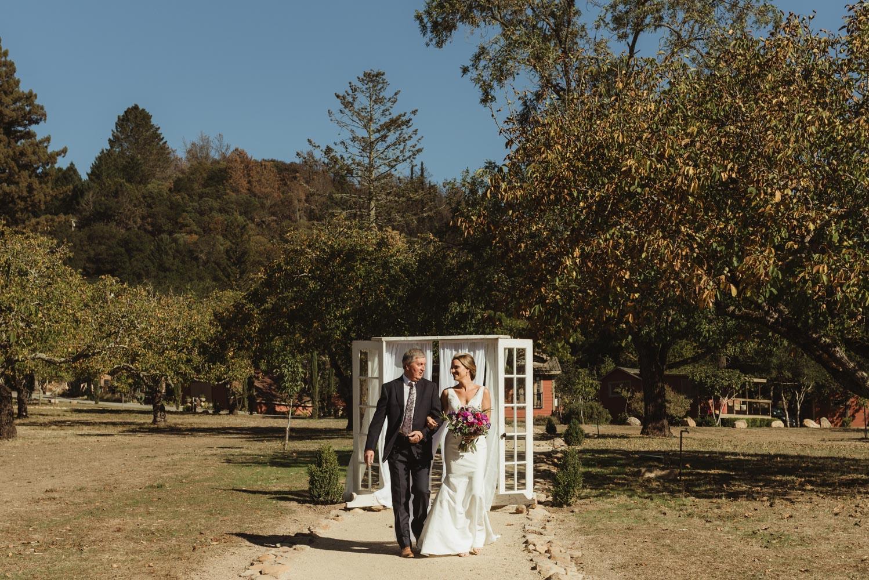 Triple S Ranch Wedding Venue, bride walking down the aisle photo