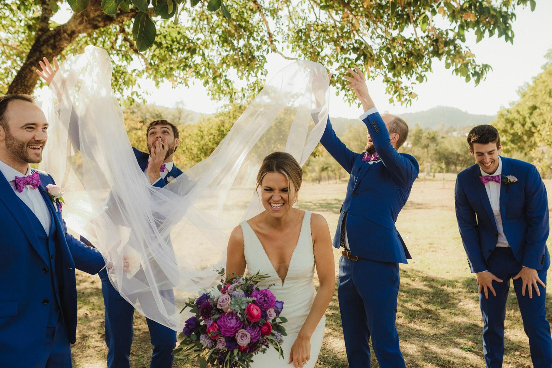Triple S Ranch Wedding Venue, bride with groomsmen photo