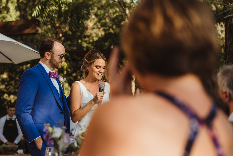 Triple S Ranch Wedding Venue, bride and groom giving a speech photo