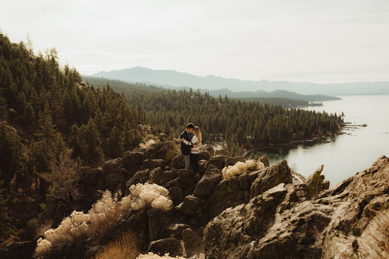 Cave Rock engagement session inspiration at Lake Tahoe, couple hugging over Cave Rock Beach