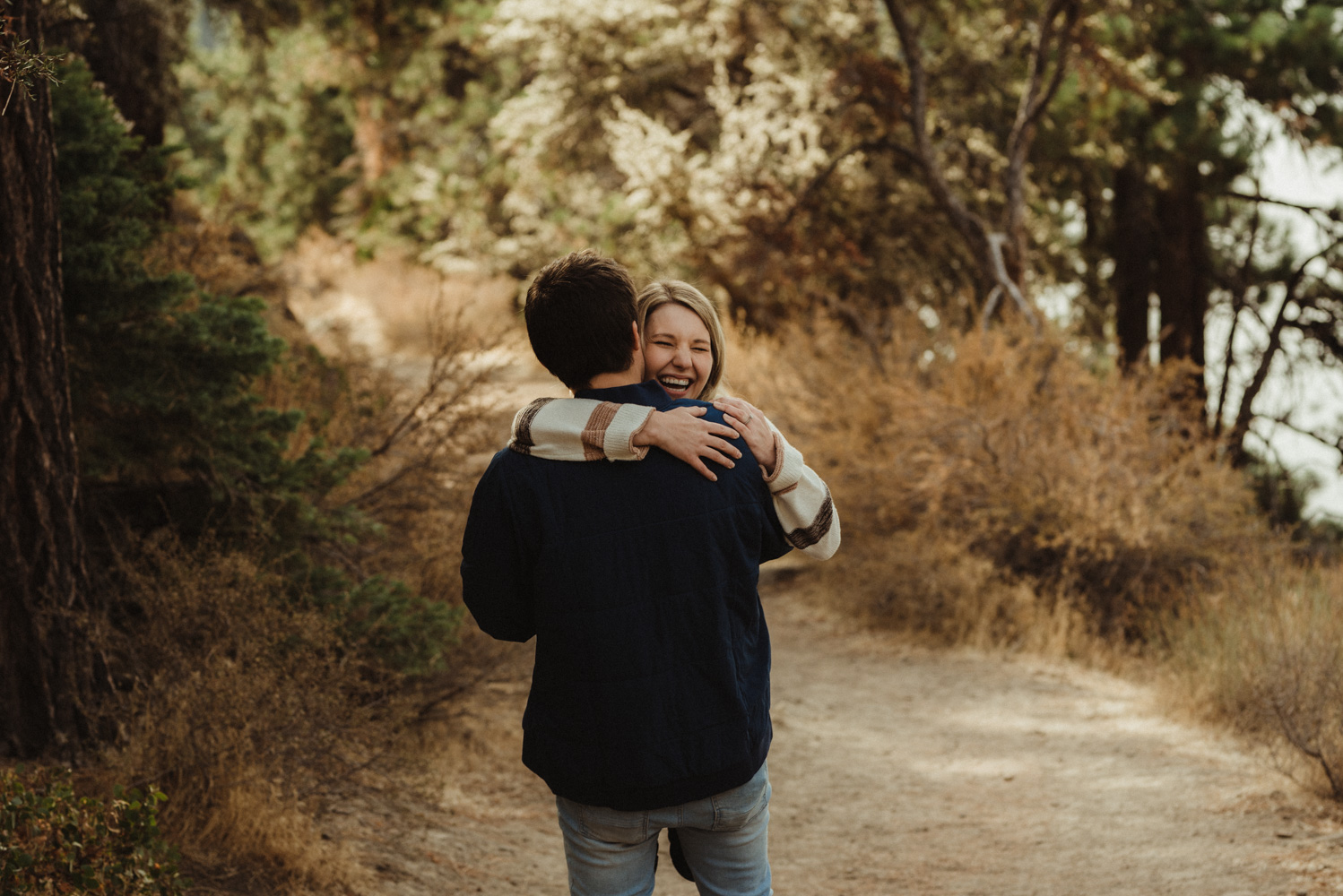 Cave Rock engagement session inspiration at Lake Tahoe,  couple hugging photo