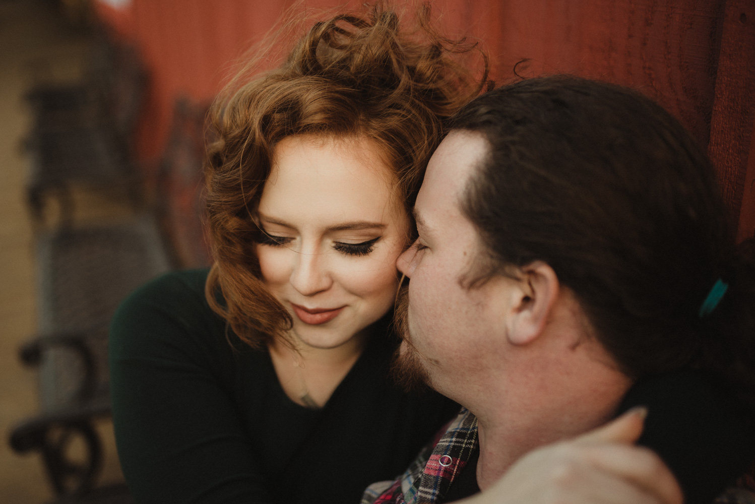 Virginia City Engagement session, couple cuddling on a bench photo