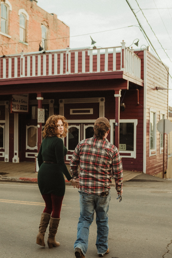 Virginia City Engagement session, couple walking across the street photo