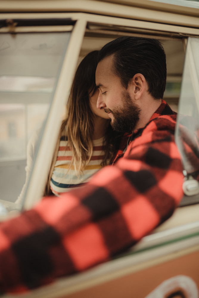 Strawberry California engagement session, couple cuddling in an old VW bus