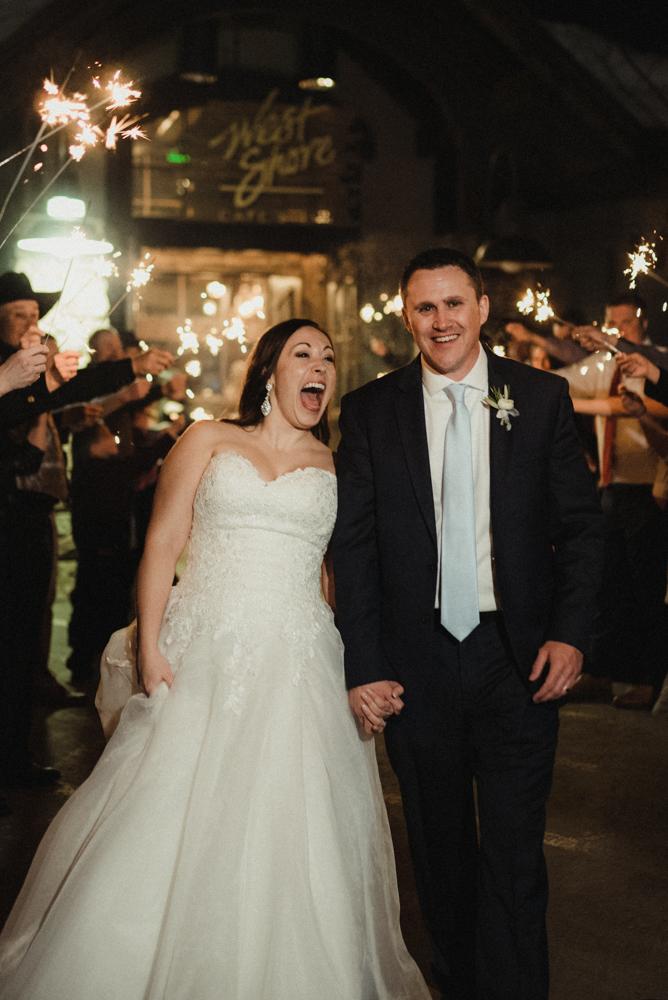 West Shore Cafe Wedding, couple walking through their sparkler exit photo