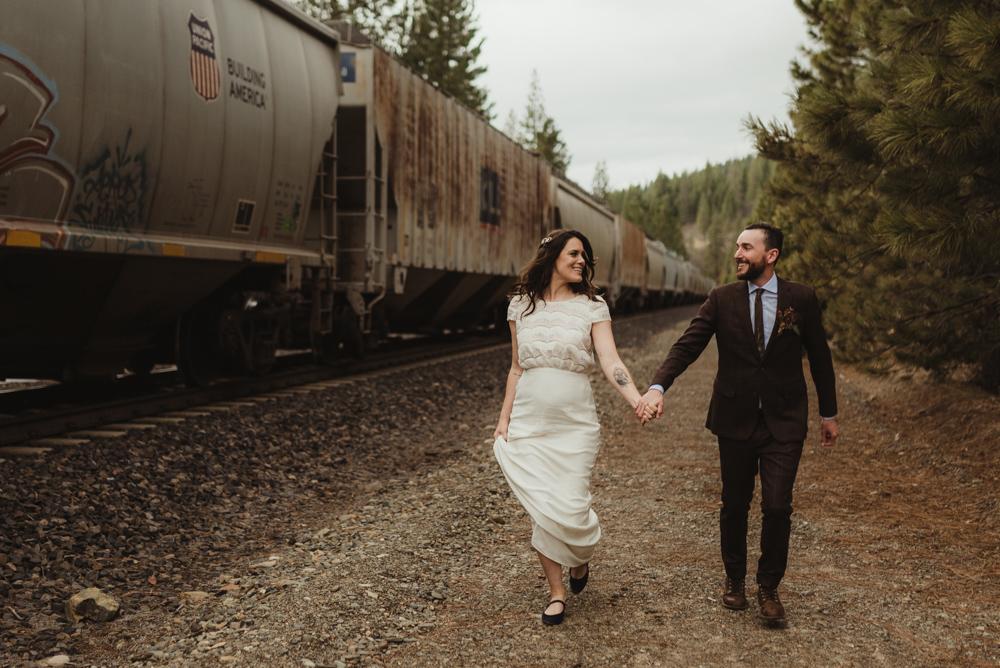 twenty mile house wedding, couple chasing a train photo
