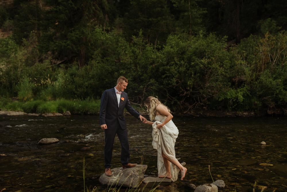 twenty mile house wedding, couple walking through the river photo