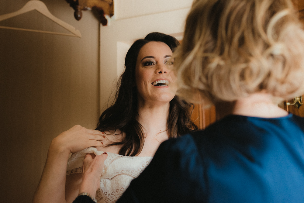 Twenty Mile House Wedding in April, bride putting on her dress photo