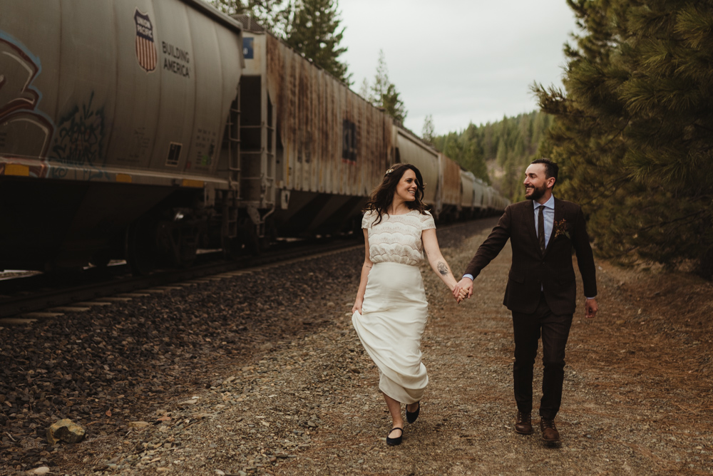 Twenty Mile House Wedding in April, couple chasing the train photo